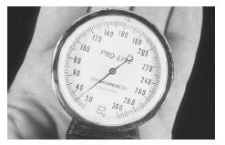 The gauge on an aneroid sphygmomanometer shows the blood pressure reading as the inflatable cuff deflates. (Custom Medical Stock Photo. Reproduced by permission.)