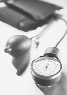 A sphygmomanometer is used to measure blood pressure. (© John Wilkes/Corbis)