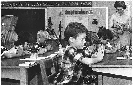 First graders pause for a moment of silent prayer in South Carolina. Reproduced by permission of the Corbis Corporation.