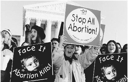 The abortion struggle has shown little evidence of changing over the years. Reproduced by permission of the Corbis Corporation.