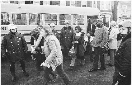 The police were often forced to monitor the bussing of African American students into white schools for the students protection. Reproduced by permission of the Corbis Corporation.